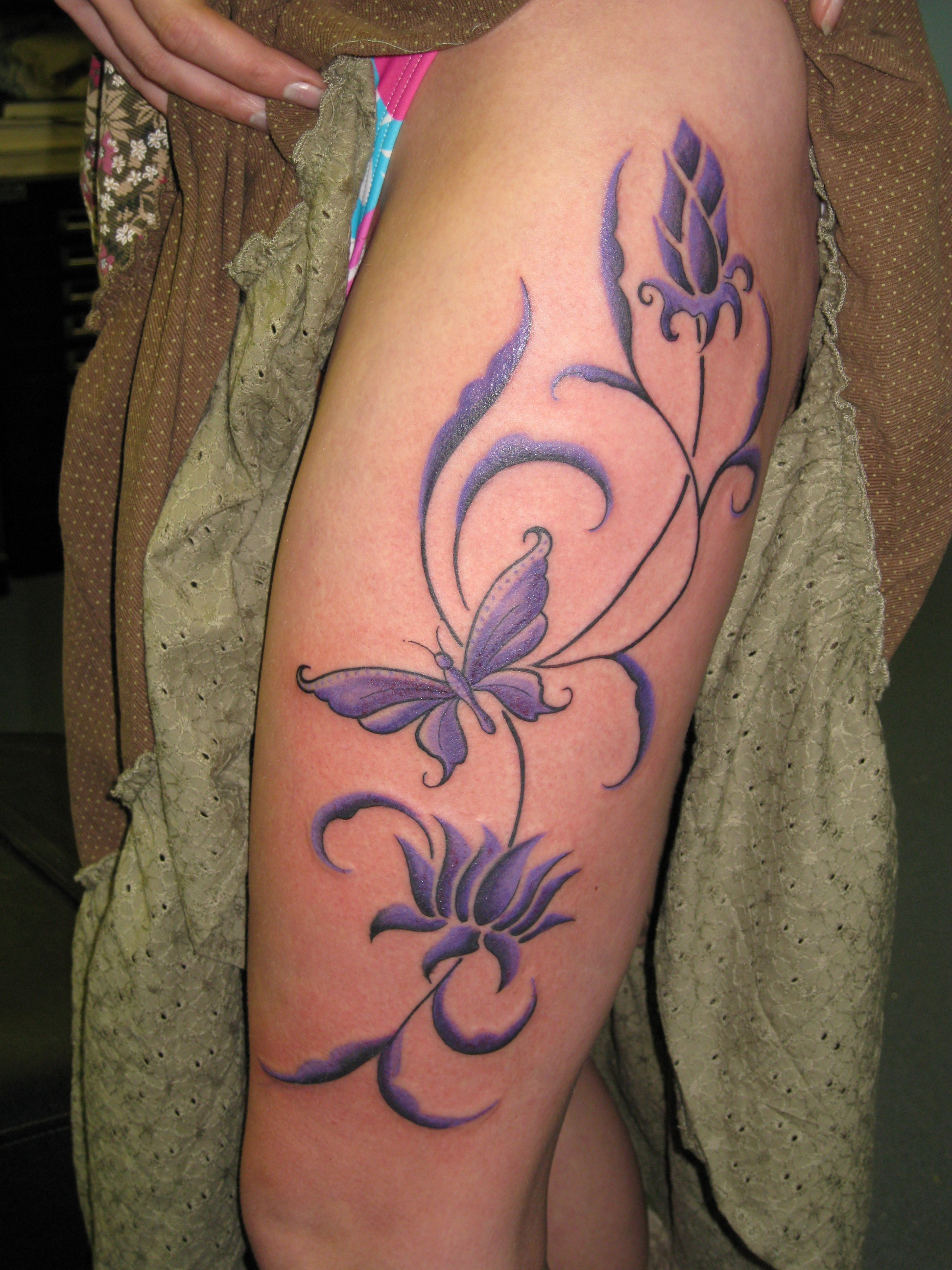 Butterfly thigh tattoo.